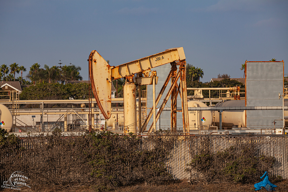 Old oil wells and pumpjacks at CRC (California Resources Corporation) facility in Huntington Beach. CRC has filed for bankruptcy and there are questions as to who be responsible for old and abandoned wells.. Orange County, California, USA