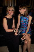 Virginia Easton and Katie Derham, Krug Christmas party, hosted by Sir Trevor Nunn and Imogen Stubbs, the Criterion, 10 December 2003. © Copyright Photograph by Dafydd Jones 66 Stockwell Park Rd. London SW9 0DA Tel 020 7733 0108 www.dafjones.com