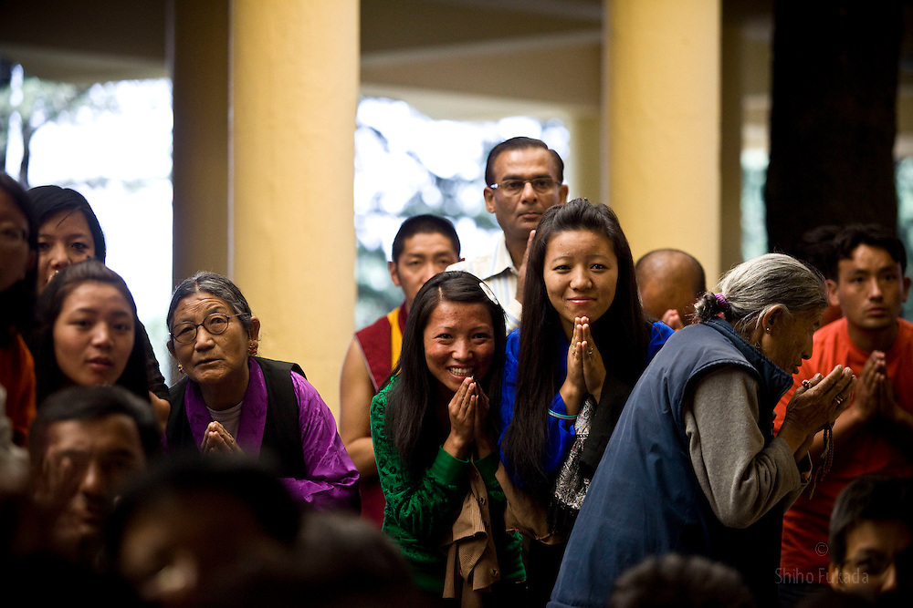 Buddhists react as they take a look at Dalai Lama during a morning prayer ceremony in Dharamsala, India, May 26, 2009.