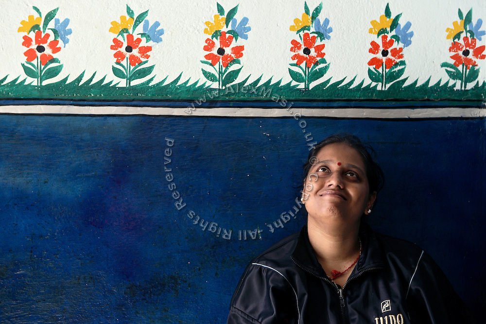 Geetan Jali Panda, 34, the wife of Biranchi Das, the recently murdered coach of Budhia Singh, is remembering her time along his husband by the entrance of their Judo Hall, in Bhubaneswar, the capital of Orissa State, on Saturday, May 17, 2008. On May 1, 2006, Budhia completed a record breaking 65 km run from Jagannath temple, Puri to Bhubaneswar. He was accompanied by his coach Biranchi Das and by the Central Reserve Police Force (CRPF). On 8th May 2006, a Government statement had ordered that he stopped running. The announcement came after doctors found the boy had high blood pressure and cardiological stress. As of 13th August 2007 Budhia's coach Biranchi Das was arrested by Indian police on suspicion of torture. Singh has accused his coach of beating him and withholding food. Das says Singh's family are making up charges as a result of a few petty rows. On April 13, Biranchi Das was shot dead in Bhubaneswar, in what is believed to be an event unconnected with Budhia, although the police is investigating the case and has made an arrest, a local goon named Raja Archary, which is now in police custody. **Italy and China Out**