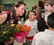 Claire Frazier, left, talks with some of her students after being awarded the Chevalier dans Ordre des Palmes Academiques by France Cultural Attache Sylvie Christophe at Kolter Elementary School, November 20, 2013.