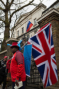 On the day that the British government awaits an explanation from the Kremlin over the poisoning by the nerve gas Novichok in Salisbury of ex-Russian spy Sergei Skripal and his daughter Yulia, a British patriot holds a Union Jack flag outside the Russian Federation Embassy and Consulate Section, on 13th March 2018, in London England.