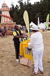 Latitude Festival, Henham Park, Suffolk, UK July 2019. Programme seller in the kids area
