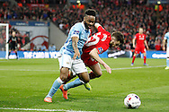 Raheem Sterling of Manchester City (l) and Adam Lallana of Liverpool battle for the ball. Capital One Cup Final, Liverpool v Manchester City at Wembley stadium in London, England on Sunday 28th Feb 2016. pic by Chris Stading, Andrew Orchard sports photography.