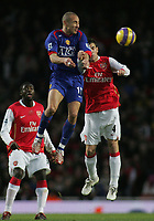 Photo: Paul Thomas.<br /> Arsenal v Manchester United. The Barclays Premiership. 21/01/2007.<br /> <br /> Man Utd's Henrik Larsson wins a header from Cesc Fabregas (R).