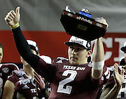 ATLANTA, GA - DECEMBER 31:  Quarterback Johnny Manziel #2 of the Texas A&M Aggies acknowledges the crowd during the trophy presentation ceremony after the Chick-fil-A Bowl game against the Duke Blue Devils at the Georgia Dome on December 31, 2013 in Atlanta, Georgia.  (Photo by Mike Zarrilli/Getty Images)