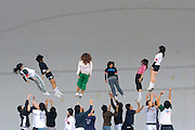 """This was a surprise - instead of just  """"hanging out"""" on the weekends, young taiwanese acrobats throw each other up in the air in the Peace Park, Taipei- and no safety net!.. city"""