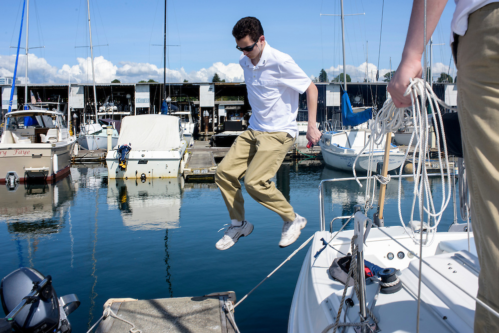 """Everett, Washington - July 13, 2015: Dressed in their naval dress uniforms Prince Aaron, left, and King Adam I, right, prep the HMNS (His Magesty's Naval Ship) Bert George at the Port of Everett Marina before venturing into the Possession Sound (part of the Puget Sound). <br /> <br /> The Bert George is named for the Oberstadt brothers' grandfather. The crown jewel of the Überstadt navy is captained by their father, High Chancellor Michael Oberstadt, not pictured. The High Chancellor does not wear Überstadti regalia. <br /> <br /> The Kingdom of Überstadt is led by nineteen-year-old King Adam I, (Adam Oberstadt). The Barony of Rosewood -- the micronation's capitol and the Oberstadt family home -- is nestled in the Seattle suburb of Mountlake Terrace, Wash. <br /> Überstadt also claims territory of nearby Edmount Island on Lake Ballinger -- called The Barony of Ballinger and """"considered the spiritual homeland of the nation."""" Both baronies reside within the Duchy of Edmount which """"is situated entirely within the boundaries of the city of Mountlake Terrace, Washington,"""" according to the Überstadt website.<br /> Überstadt  was founded by King Adam I and his high school friends March 6, 2010, and was governed by judges as a kritarchy. Before taking the crown, Adam was Überstadt's chief judge. After graduation, many of the Überstadti moved away to college and Überstadt's populace shrank. Activities would shift from the high school to Rosewood, and the governing style morphed to a unitary constitutional monarchy. According to the micronation's website Überstadt is a sovereign state """"guided by the principles of direct democracy, socialist economics, and environmentalism."""" <br /> <br /> CREDIT: Matt Roth"""