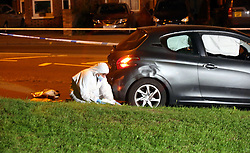 """Reading,Berkshire Monday 30th May 2016<br /> <br /> Police launch investigation after a man has been shot at Prospect Park in Reading this evening.<br /> A man has been airlifted to hospital after being shot by a weapon on the Tilehurst Road side of the park.<br /> <br /> A Blue Peugeot 306  sits on the footpath with windows shot out and a  flat  tyre with bedspreads that near by residents used to help stem the bleeding of the from the  man wounds.<br /> A  large number police remain  in and around the area of where the incident happened and  where the air ambulance landing at the centre of the park.<br /> <br /> The shooting  took place yard from a child play park area.<br /> <br /> Police were called to Prospect Park at around 8pm today after reports that a man had been shot.<br /> <br /> The victim, a 23 year-old man, was located at the scene with a gunshot wound.<br /> <br /> He was taken to hospital by air ambulance and is currently in a stable condition.<br /> <br /> Local Policing Area Commander for Reading, Supt Stan Gilmour said: """"I would like to reassure the public that this attack appears to have been targeted against an individual and does not represent a threat to the community.<br /> <br /> """"A thorough investigation is being carried out, which means there will be an increased police presence in the area in the coming days. If you have any concerns or information to pass on then please approach one of our officers.<br /> <br /> """"Tilehurst road remains closed at this time. We would like to thank the public for their co-operation.""""<br /> <br /> Investigating officer, Det Insp Jon Groenen, of Force CID, based at Reading police station said: """"I would like to appeal to anyone who witnessed this offence or has any information to contact police.<br /> <br /> """"If you do not want to speak directly to the police you can contact the independent charity Crimestoppers anonymously on 0800 555 111. No personal details are taken, information is not traced or recorded a"""