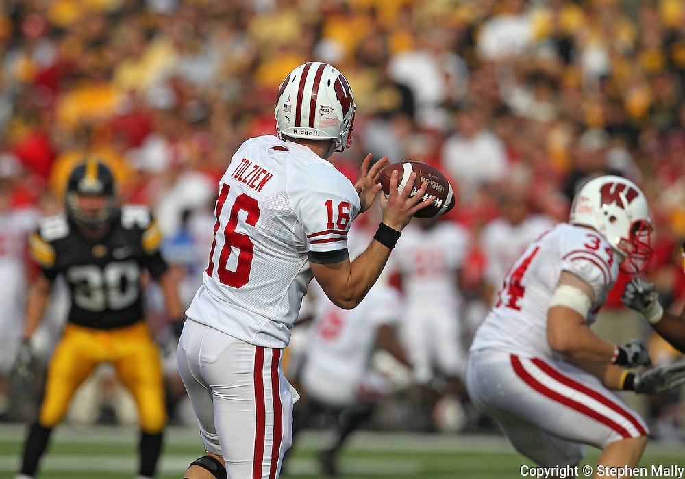 October 23 2010: Wisconsin Badgers quarterback Scott Tolzien (16) looks for a receiver during the first half of the NCAA football game between the Wisconsin Badgers and the Iowa Hawkeyes at Kinnick Stadium in Iowa City, Iowa on Saturday October 23, 2010. Wisconsin defeated Iowa 31-30.