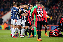 West Bromwich Albion's Kieran Gibbs (second left) puts himself between AFC Bournemouth's Callum Wilson (centre) and West Bromwich Albion's Claudio Yacob (left) after the latter brings down AFC Bournemouth's Adam Smith (right) during the Premier League match at the Vitality Stadium, Bournemouth.