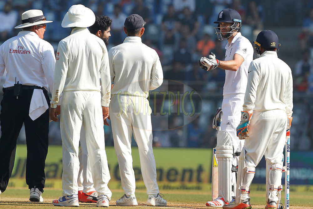 James Anderson of England talk with Virat Kohli Captain of India during day 5 of the fourth test match between India and England held at the Wankhede Stadium, Mumbai on the 12th December 2016.<br /> <br /> Photo by: Deepak Malik/ BCCI/ SPORTZPICS