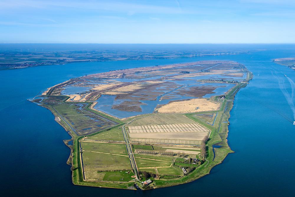 """Nederland, Zuid-Holland, Tiengemeten, 01-04-2016; oostelijk deel van het eiland Tiengemeten met zorgboerderij en camping. Het eiland werd oorspronkelijk gebruikt voor de akkerbouw maar is inmiddels 'teruggegeven aan de natuur': de dijken zijn deels doorgestoken en de laatste boer is in 2006 vertrokken. De 'nieuwe natuur' vormt onderdeel van de Ecologische Hoofdstructuur.<br /> The island Tiengemeten in the Haringvliet, was originally used for agriculture but has now """"been given back to nature"""". Large parts have been flooded and the isle is part of the National Ecological Network. The last farmer left in 2006. Current use, among other, care farms and camping. luchtfoto (toeslag op standard tarieven);<br /> aerial photo (additional fee required);<br /> copyright foto/photo Siebe Swart"""
