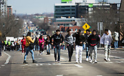 High school students march down East Washington towards the State Capitol in support of stronger gun regulation and legislation in Madison, Wisconsin, Wednesday, March 14, 2018.