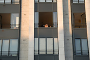 """April, 10th 2020 - Paris, Ile-de-France, France: Parisian apartment, sunbathing and self isolating, in the hope of protecting themselves from the spread of the Coronavirus, during the end of the first month of near total lockdown imposed in France. A week after President of France, Emmanuel Macron, said the citizens must stay at home for at least 15 days, that has been extended. He said """"We are at war, a public health war, certainly but we are at war, against an invisible and elusive enemy"""". All journeys outside the home unless justified for essential professional or health reasons are outlawed. Anyone flouting the new regulations is fined. Nigel Dickinson"""