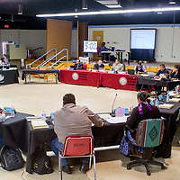 Members of the Navajo Nation Council delegates conduct a special session at their temporary chambers in the Navajo Nation Department of Education in Window Rock Monday.