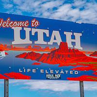A road sign welcomes travelers to Utah, near Navajo Mountain, Utah,