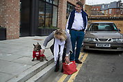 Dogs and their owners gather for the Doggie Cinema at Wringer and Mangle on 3rd April 2016 in Hackney, London, United Kingdom. Both human and dog equally enjoying the screening of acclaimed 2009 animation 'My Dog Tulip'. At the event, the four-legged filmgoers have dog-friendly refreshments.