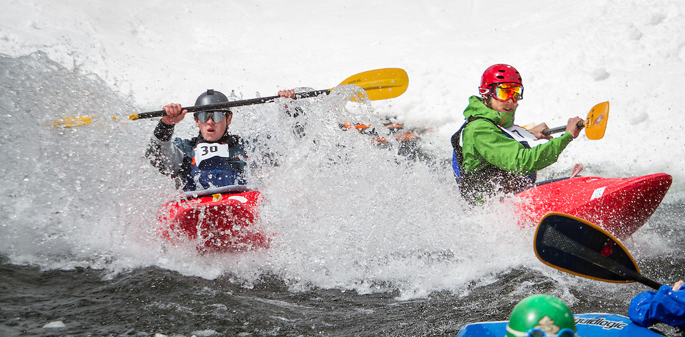 Competitors in the annual Kayaks on the Snow race down a prepared course on Freeway at Monarch Mountain, and then must paddle through a pond.