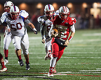 Riley Roy charges the ball towards the endzone during Friday night football with Trinity.  (Karen Bobotas/for the Laconia Daily Sun)