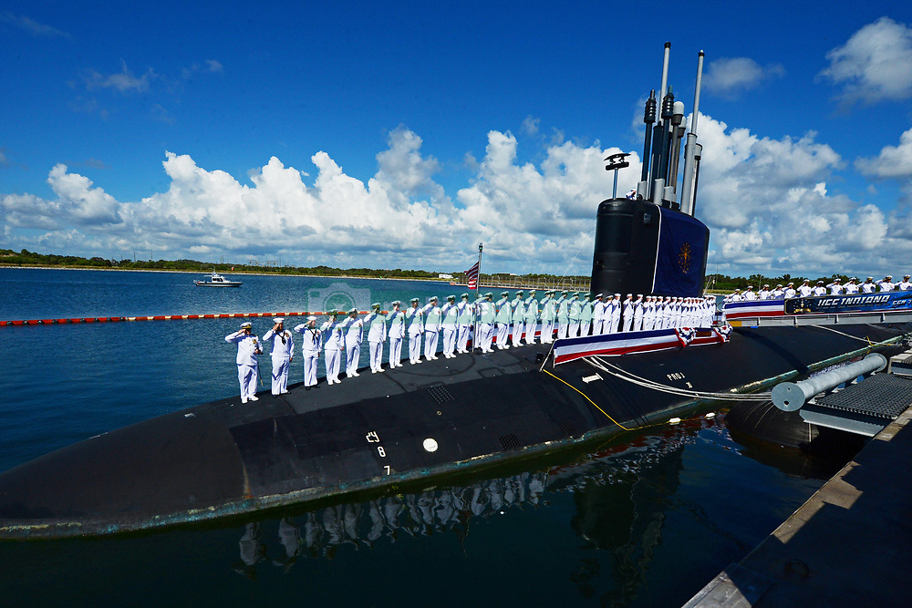 PORT CANAVERAL, Fla. (Sept. 29, 2018) The crew of USS Indiana (SSN 789) salute after brining the ship to life during the commissioning ceremony.  Indiana is the U.S. Navy's 16th Virginia-class fast-attack submarine and the third ship named for the State of Indiana. (U.S. Navy photo by Senior Chief Mass Communication Specialist Leah Stiles/Released)