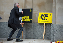 © Licensed to London News Pictures. 20/10/2015. London UK. Human rights protestors gather on The Mall in London leading to Buckingham palace as Chinese President Xi Jinping starts day one of a four day State Visit to the United Kingdom. Photo credit: Ben Cawthra/LNP