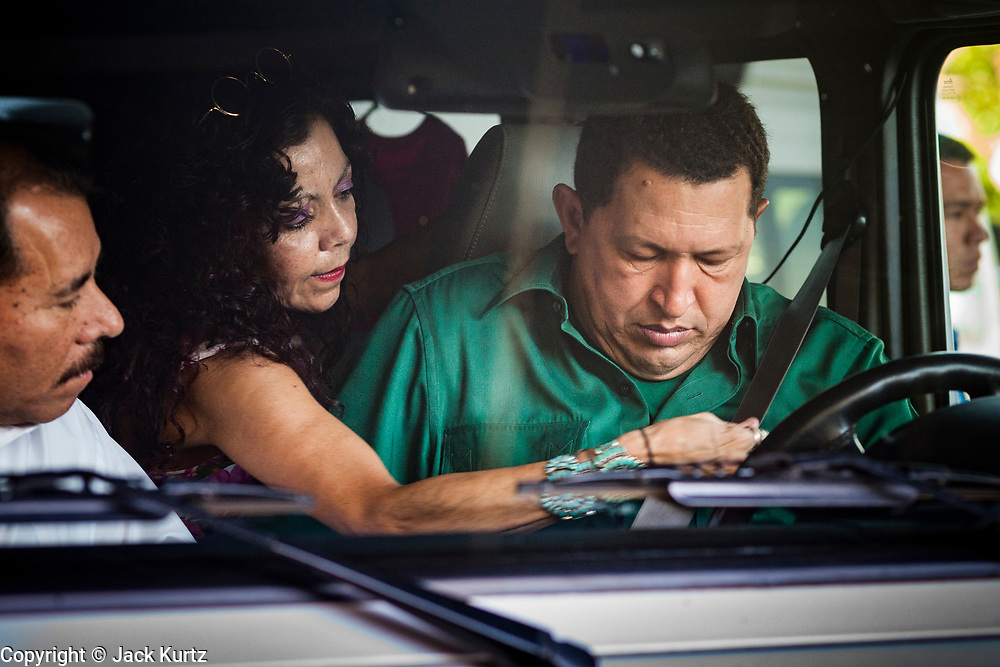 12 JANUARY 2007 - MANAGUA, NICARAGUA: ROSARIO MURILLO, wife of Nicaraguan President Daniel Ortega, helps HUGO CHAVEZ, President of Venezuela put on his seat belt in Managua before Chavez drove himself, Murillo and Ortega to the Managua airport when Chavez left Nicaragua to return to Venezuela. Chavez has promised massive amounts of aid  for Nicaragua including free and discounted oil and portable electric generating stations. Nicaragua is the second poorest country in the western hemisphere.  Photo by Jack Kurtz