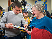 28 DECEMBER 2019 - DES MOINES, IOWA: Mayor PETE BUTTIGIEG, left, signs a book for a person during a meet and greet with Buttigieg in Des Moines. Buttigieg talked to a crowd of about 75 people at Urban Dreams, an African-American community empowerment center in Des Moines. It was a part of Buttigieg's continuing outreach to African-American voters. Buttigieg, the mayor of South Bend, Indiana, is running to be the Democratic nominee for President in the 2020 election. Iowa traditionally holds the first presidential selection event of the 2020 election cycle. The Iowa Caucuses are on Feb. 3, 2020.           PHOTO BY JACK KURTZ