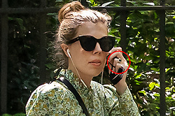 © Licensed to London News Pictures. 08/06/2021. London, UK. Carrie Johnson, Wife of Prime Minister Boris Johnson, wears a large ring on her left hand (circled in red) as she walks in Westminster.  Photo credit: George Cracknell Wright/LNP