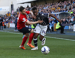Millwall's Fred Onyedinma glides past Blackburn Rovers' Craig Conway- Photo mandatory by-line: Robin White/JMP - Tel: Mobile: 07966 386802 29/03/2014 - SPORT - FOOTBALL - The Den - Millwall - Millwall v Blackburn Rovers - Sky Bet Championship