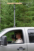 Wildlife biologists use radio telemetry equipment to locate elk near Clam Lake, Wisconsin