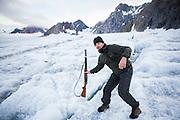 Acoustics specialist Krysztof Herman (helping out with glacier field work) navigates the crevassed surface of Samarinbreen, Hornsund, Svalbard using his (polar bear) rifle as a probe.