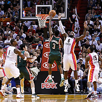 22 January 2012: Milwaukee Bucks point guard Brandon Jennings (3) goes for the floater over Miami Heat small forward LeBron James (6) during the Milwaukee Bucks 91-82 victory over the Miami Heat at the AmericanAirlines Arena, Miami, Florida, USA.