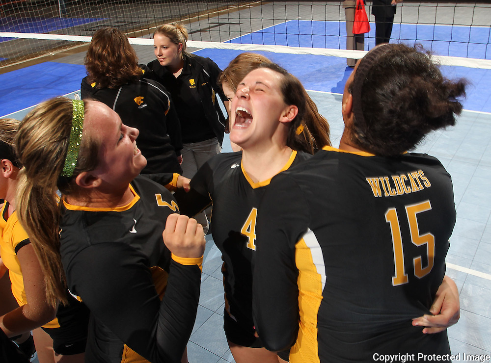 Janesville's Shelby Murley (5), Karli Kruse (4), and Olivia Fisher (15) celebrate their win following the fourth game of their 1A semifinal match in the state volleyball tournament at the U.S. Cellular Center at 370 1st Ave E on Friday evening, November 12, 2010. (Stephen Mally/Freelance)