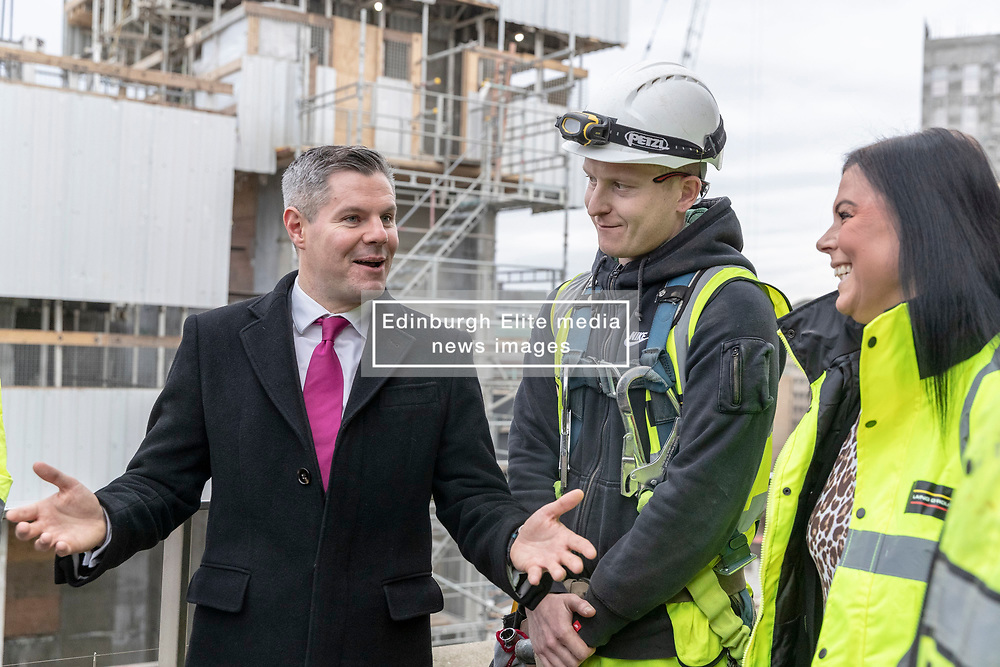 Finance Secretary Derek Mackay visits the Edinburgh St James Centre development ahead of the 2019-20 Scottish Budget.<br /> <br /> Mr Mackay will present the 2019-20 Scottish Budget on Wednesday 12th December.<br /> <br /> Edinburgh St James is a 1.7 million sq ft city centre development and one of the largest and most significant regeneration projects currently underway in the U.K. and the largest city-centre development Edinburgh has seen for decades. The scheme will strengthen Edinburgh's global standing by transforming the city's east end into an inspiring, attractive and vibrant destination.<br /> <br /> Pictured: Derek McKay with apprentices who have been employed during the construction of the site <br /> <br /> *PICTURES EMBARGOED UNTIL 00:01 ON WEDNESDAY 12 DECEMBER 2018*