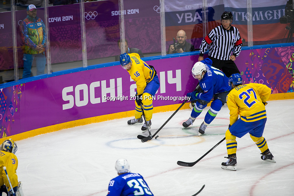Marcus Kruger (SWE)-16, Anze Kopitar (SLO)-11 during Sweden vs Slovenia game at the Olympic Winter Games, Sochi 2014