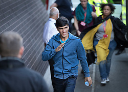 © Licensed to London News Pictures. 18/10/2016. Croydon, UK. A migrant waves to a group of charity workers as he arrives from the Calais jungle camp at the Home Office immigration centre in Croydon. British authorities are bringing over about 100 children this week to be reunited with their relatives. The French government have announced that they will be dismantling the camp this month. credit: Peter Macdiarmid/LNP