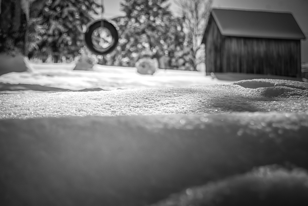 Abstract of an old barn covered in a blanket of snow.