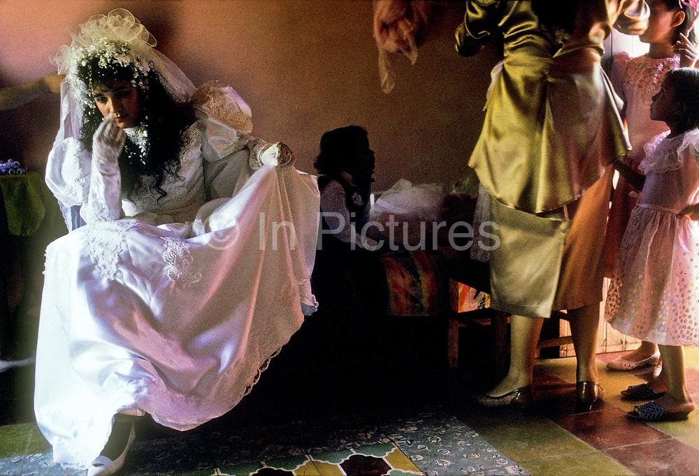 Maria Saravia Gracia, nervously prepares for her wedding ceremony, Anamoros, El Salvador.