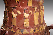 Close up of the Inandik Hittite relief decorated cult libation vase decorated with women relief figures coloured in cream, red and black playing instruments, mid to late 16th century BC - İnandıktepe, Turkey . Against a grey background