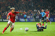 Charlton Athletic forward Lyle Taylor (9) has a shot on goal during the EFL Sky Bet League 1 second leg Play-Off match between Charlton Athletic and Doncaster Rovers at The Valley, London, England on 17 May 2019.