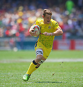 Con Foley of Australia on his way to scoring a try during the Hong Kong Sevens 2015 match between Australia Sevens and Scotland Sevens at the Hong Kong Stadium, Hong Kong on 28 March 2015. Photo by Ian Muir....during the Hong Kong Sevens 2015 match between ........... at Hong Kong Stadium, Hong Kong on 27 March 2015. Photo by Ian Muir.