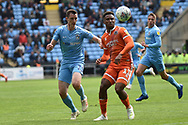 Shrewsbury Town striker (on loan from Stoke City) Tyrese Campbell (11) battles for possession  with Coventry City defender Dominic Hyam (15) during the EFL Sky Bet League 1 match between Coventry City and Shrewsbury Town at the Ricoh Arena, Coventry, England on 28 April 2019.