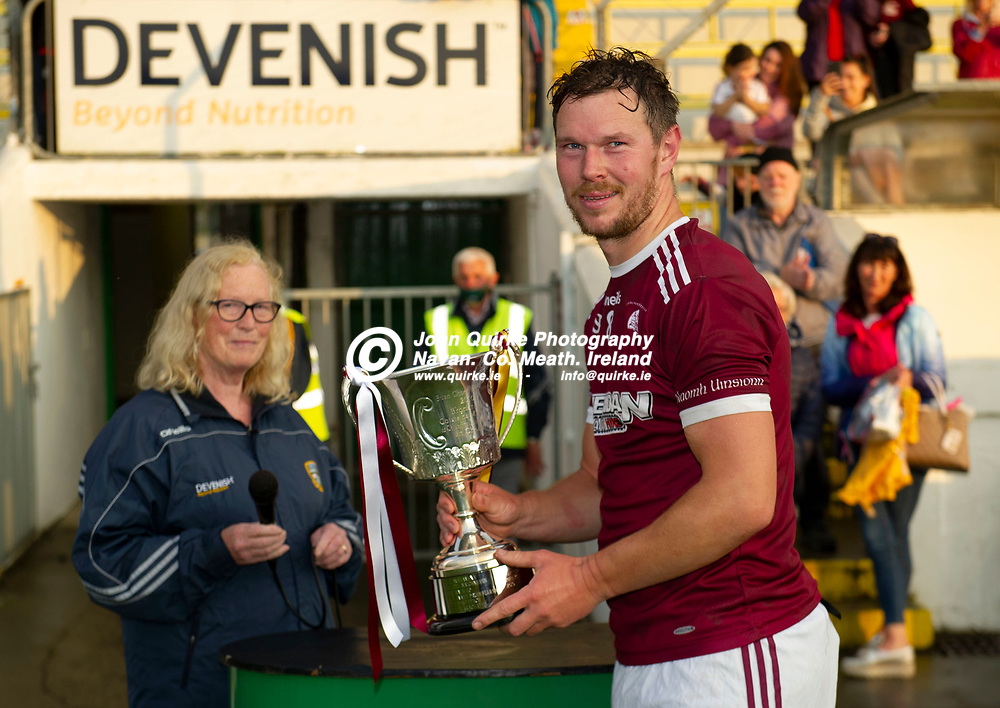 27-07-21. Carnaross v St. Vincent's Tailteann Cup Final 2020.<br /> Mairead Delaney, Secretary, Meath GAA presenting the Tailteann Cup to St, Vincent;s captain Robert Tallon.<br /> Photo: John Quirke / www.quirke.ie<br /> ©John Quirke Photography, 16 Proudstown Road, Navan. Co. Meath. (info@quirke.ie / 046-9028461 / 087-2579454).
