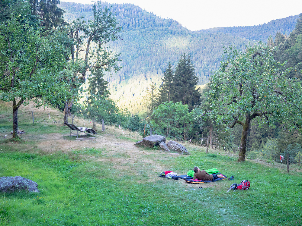 Male hiker taking rest on meadow, Baden-Wuerttemerg, Germany