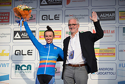 Katarzyna Niewiadoma (Rabo-Liv Cycling Team) and Brian Cookson, the president of the UCI stand on the podium, after the Trofeo Alfredo Binda - a 123.3km road race from Gavirate to Cittiglio on March 20, 2016 in Varese, Italy.