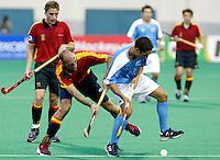 10th Men's World Cup Fieldhockey. New Zealand vs Spain. Duel between Spanish Juan Escarre and Newzealand-Mitesh Patel (r) left Spanish Xavier Arnau.