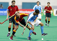 10th Men's World Cup Fieldhockey. New Zealand vs Spain. Duel between Spanish Juan Escarre and Newzealand-Mitesh Patel (r) left Spanish Xavier Arnau.