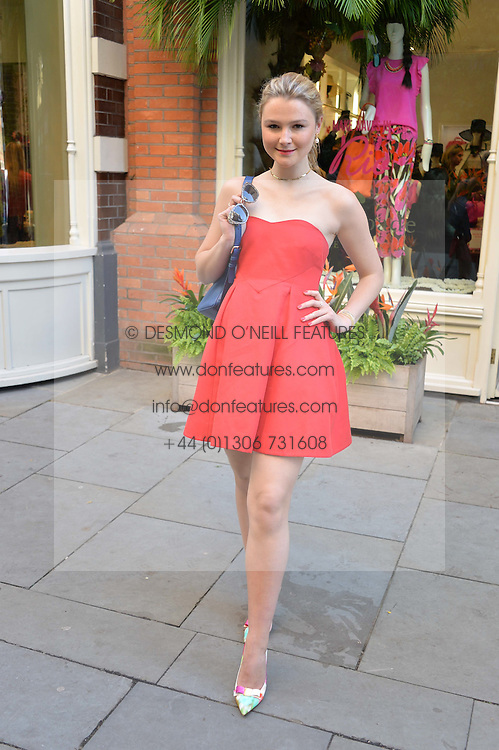 AMBER ATHERTON at a 'Tropical fete' at Kate Spade New York, 2 Symons Street, Sloane Square, London in celebration of the Chelsea Flower Show on 22nd May 2014.