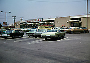 Historic vintage cars parked in car park of Safeway supermarket store in USA 1976